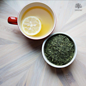 cup of brewed green tea Sencha loose green tea leaves