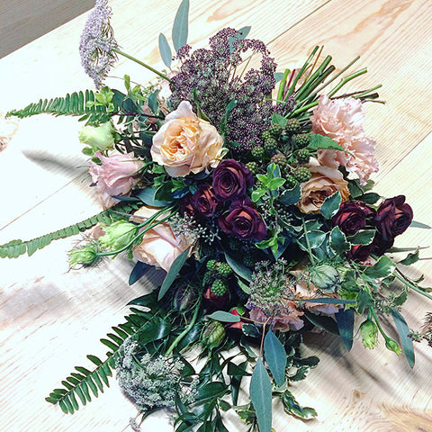 wedding bouquet with peachy and burgundy tones