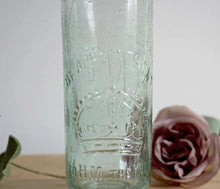 Three gorgeous antique glass stoppered bottles, one from each part of Great Britain.