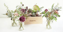 A selection of seasonal flowers set in either 4 or 6 jam jars and contained in a handmade wooden box.