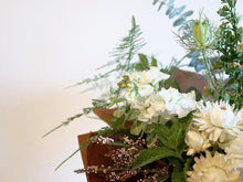 A bouquet full of summer flowers in a soft cappuccino/tan and creamy white color palette with lots of greenery.