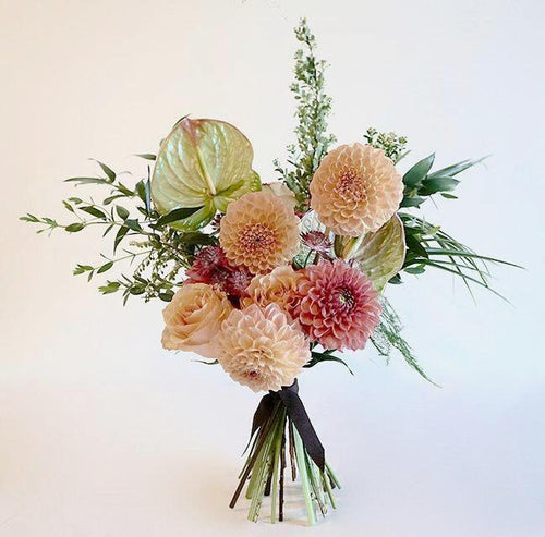 Peach, pinky orange and green summer bouquet