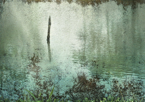 Old post emerges from water in this fantasy scape created from a composite of wall texture and a lake