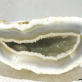 Agate Geode with Wise Guy Crystal Smirk | New Earth Gifts