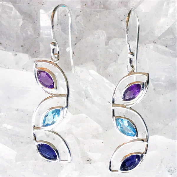 "Sterling Mixed Gem Earrings of Cascading Leaves feature faceted Marquis-shaped Amethyst, Blue Topaz and Iolite gemstones. The precious earrings are 1.5"" long. New Earth Gifts"