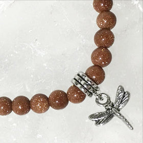 Goldstone Bracelet with Rhodium Dragonfly Charm | New Earth Gifts