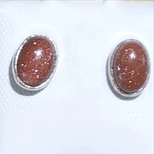 "Sterling Silver Goldstone Stud Earrings. Delicate 1/2"" x 1/4"" ovals show off Goldstone's rich color and sparkling essence. Very popular stone for all seasons. New Earth Gifts"