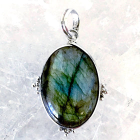 "Labradorite Pendant Victorian Style set in Sterling Silver evokes a time of ornamental wonder and queenly beauty. The beautiful Labradorite pendant is 2""x1.25"". - New Earth Gifts"