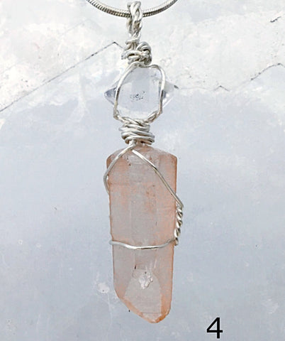 Lemurian & Herkimer Diamond Pendant is wire wrapped to highlight the crystals' natural beauty.