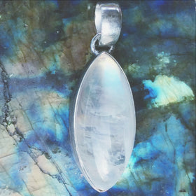 "A stunning Rainbow Moonstone Pendant Marquis Style is simply set in sterling silver to place focus on the Moonstone's beautiful glow. The pendant is 1.5"" x .5"". New Earth Gifts"