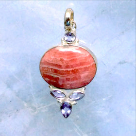 "A gorgeous Rhodochrosite Oval Pendant with Faceted Marquis Amethyst Accents is set in sterling silver. Unusual elongated oval with amethyst accents. 1.5"" x .5"". - New Earth Gifts"