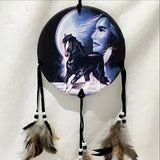 "The Medicine Shield of Maiden with Black Horse and Full Moon is 6"" round and hangs 24"" from top to bottom of feathers. Haunting Native American spiritual images. New Earth Gifts"
