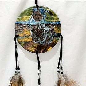 "Medicine Shield Warrior with Wolf Reflection is 6"" round and hangs 24"" from top to bottom of feathers. The image depicts the warrior's connection to his animal spirit. New Earth Gifts"