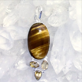 "The combination in this Tiger Eye and Citrine Sterling Silver Pendant is stunning! Faceted Citrine gemstones adorn the bottom of an oval Tiger Eye. 2"" long. - New Earth Gifts"