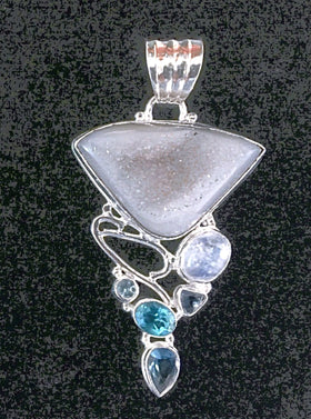 The Agate Drusy Pendant with Rainbow Moonstone, Blue Topaz, Iolite  Accents is an unusual and beautiful, one of a kind statement piece set in sterling silver.  - New Earth Gifts