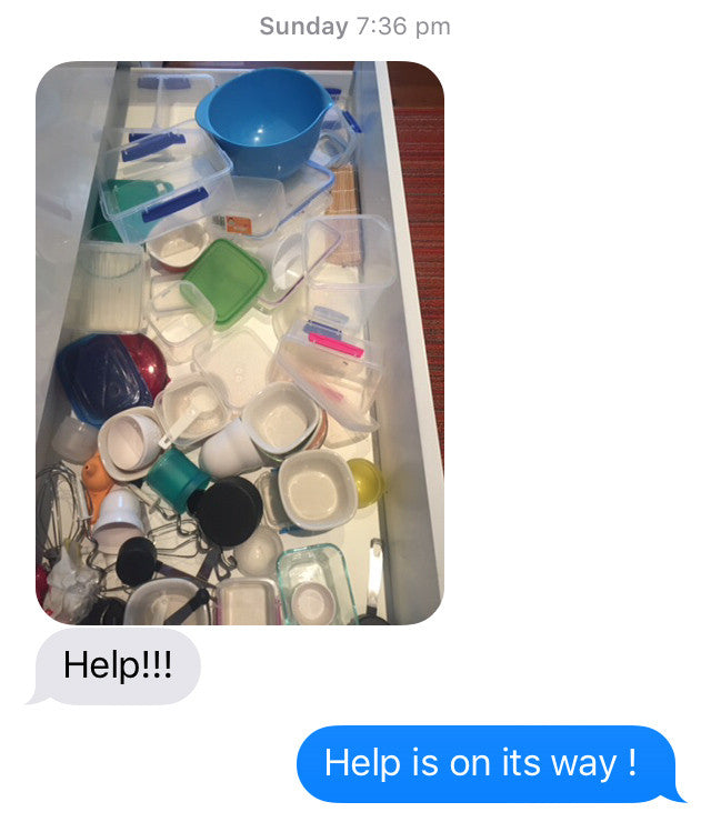 kitchen drawer filled with messy plastic food containers