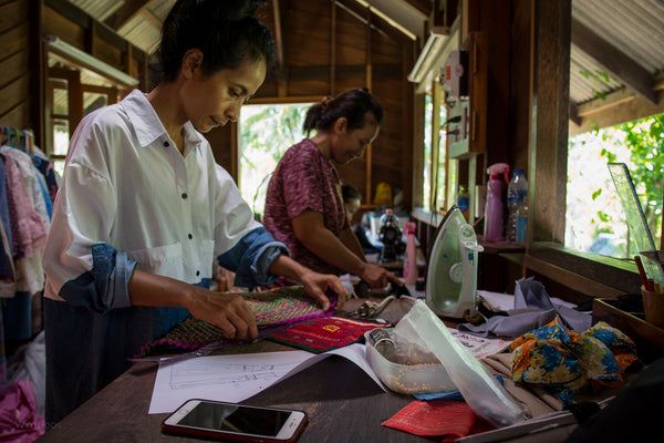 Nuichan sisters at work creating new designs from hill tribe fabrics