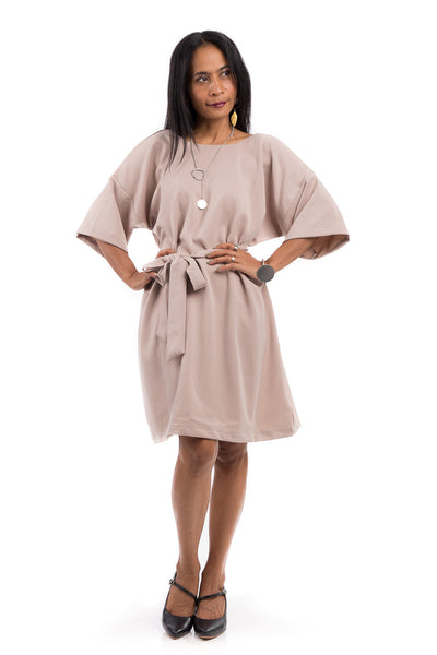Short summer dress with half length sleeves.  Modest neckline with waistband accent.  Above the knee length dress.