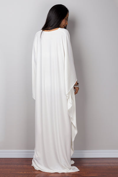 Off white caftan.  Loose fit off white maxi dress.  White frock dress with plunging neckline.