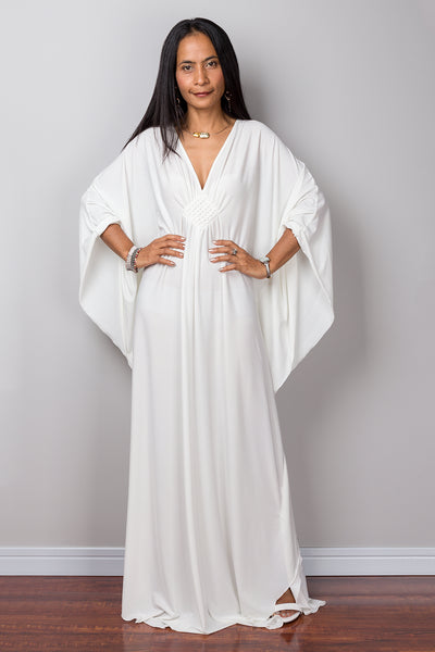 Buy Off white kaftan online.  Shop for white maxi dress by Nuichan.  White frock dress with plunging neckline.
