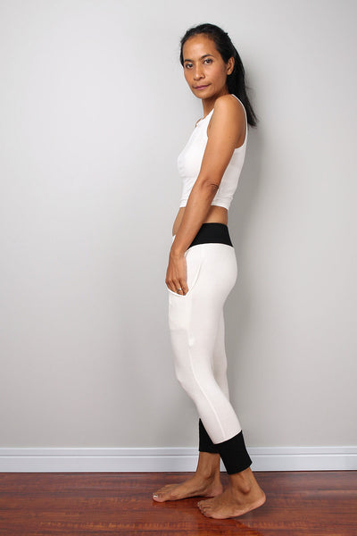 off-white legging pants with black cuffs on the bottom, off-white yoga pants by Nuichan