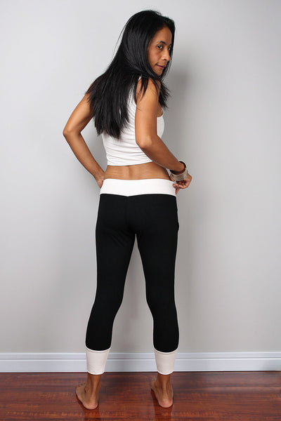 Black legging pants with white cuffs on the bottom, black yoga pants by Nuichan