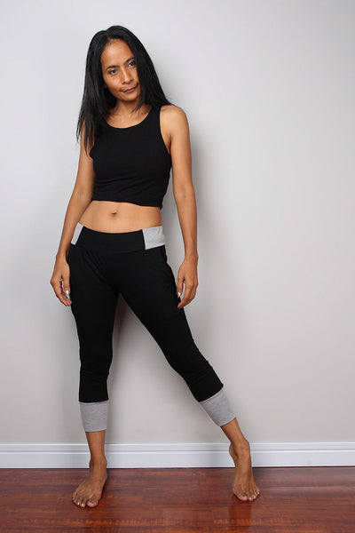 Black legging pants with grey cuffs on the bottom, black yoga pants by Nuichan