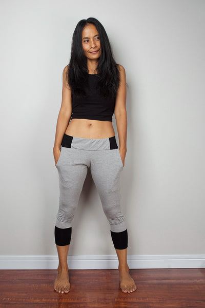 Grey legging pants with black cuffs on the bottom, grey yoga pants by Nuichan