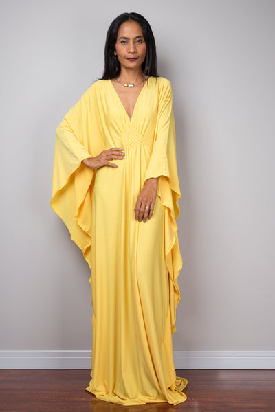 Yellow kaftan dress.  Large loose fit dress with plunging neckline in a soft yellow solid fabric.  A wide sleeve oversized maxi dress by Nuichan.