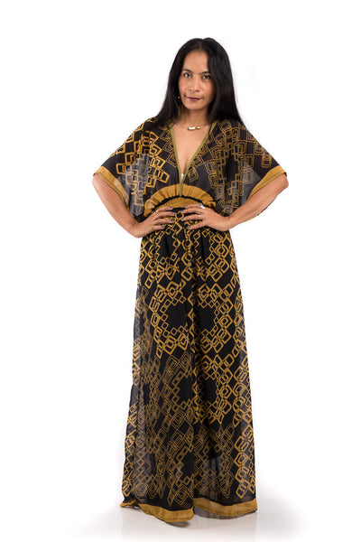 Boho summer dress.  Chiffon maxi dress with plunging neck line on front and back.  Golden yellow print on black fabric.  Smocked waist to ensure good fit.  Kimono inspired dress by Nuichan