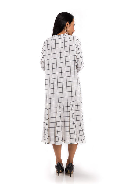 Knee length dress.  White dress with black square print.  Modest neckline and long sleeves.  Tube dress with pleated bottom part by Nuichan.