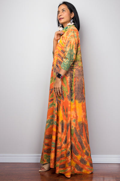 Loose fit maxi dress with wide sleeves and a gorgeous boho print on a black and white background. Ideal summer kaftan.