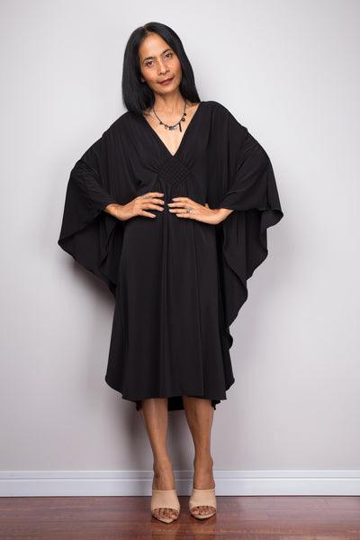 Buy Short black dress online.  Black kaftan dress  by Nuichan. Affordable black midi dress with plunging neckline
