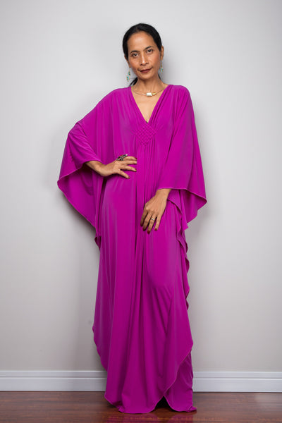 Shop for kaftan dresses online.  Magenta caftan dress by Nuichan.  A plus size purple kaftan dress with plunging neckline.