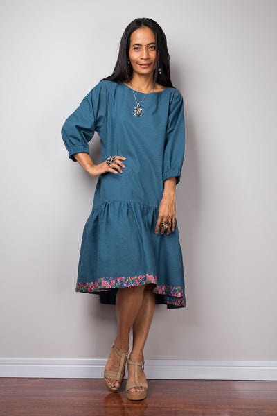 Midi dress with sleeves and floral detail