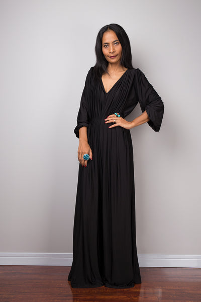 Black jumpsuit with high waist and plunging neckline.  Long sleeved pleated black jumper.