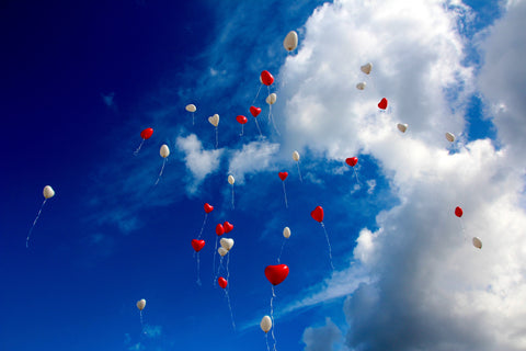 Heart balloons floating away