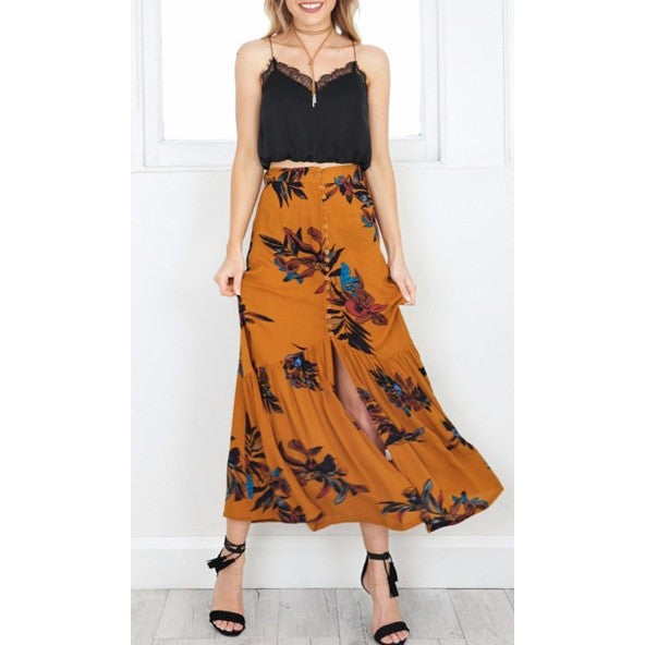 The Anna Skirt is a high waist, floral print designed boho-style full length maxi skirt with a split in the center for a more roomy feel. Great for casual, everyday wear or as a cover up at the summer beach!