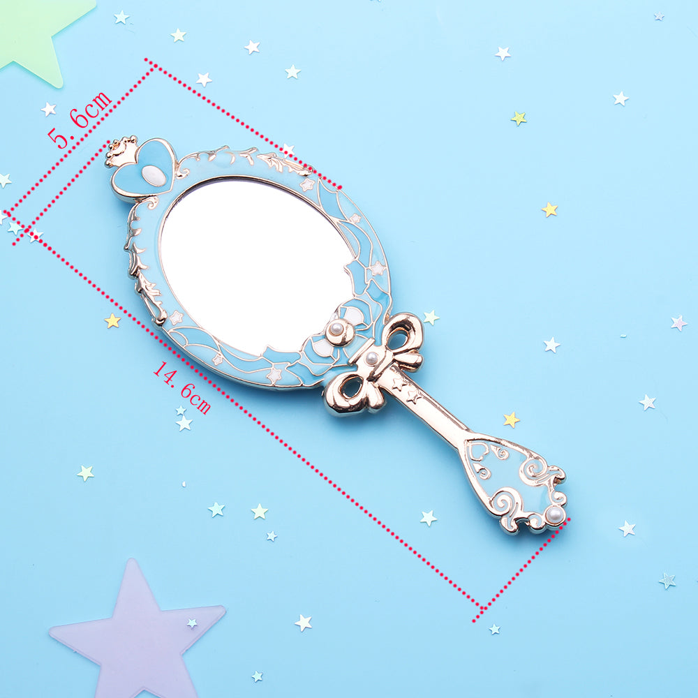 This small handheld mirror is a cute & kawaii, feminine accessory & gift for any Sailor Moon anime fan. Blue variant of the Spiral Heart Moon Rod themed design.