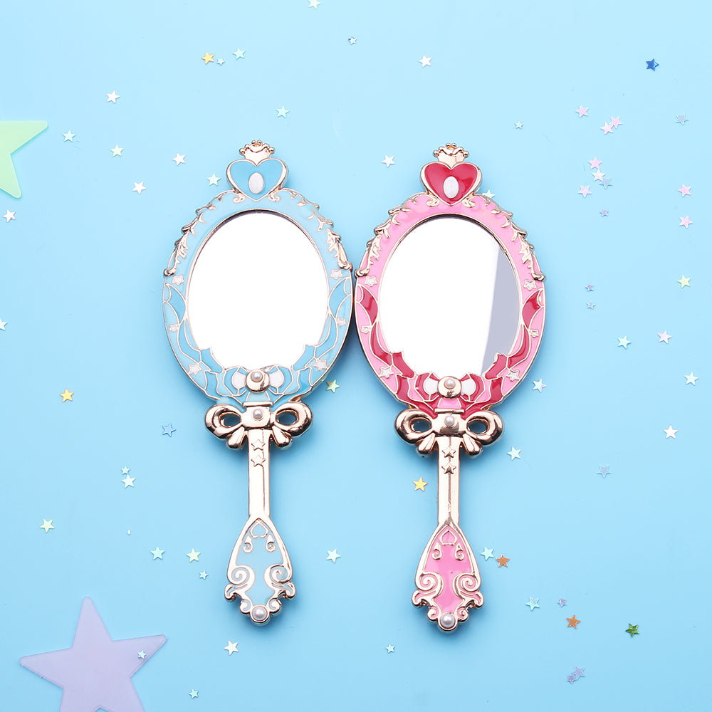 This small handheld mirror is a cute & kawaii, feminine accessory & gift for any Sailor Moon anime fan. Pink variant of the Spiral Heart Moon Rod themed design.