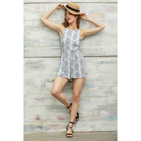 The Adele romper is a beautiful floral, tiled patterned romper which is comfortable and perfect for the summer beach or casual wear! Sleeveless, shorts style with spaghetti straps, and back-tie for cutout style and cute bow for a feminine look.
