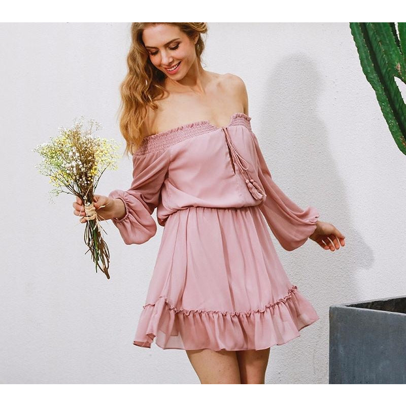 The Charlotte Dress is an adorable, off-shoulder style dress with a ruffled hem and lantern sleeves.