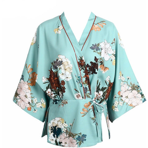 The Ai Kimono robe is a beautiful summer layering top with wide, nine-quarter sleeves and featuring a floral print on top of a gorgeous seafoam color. Various sizes available with side tie for easy adjusting!