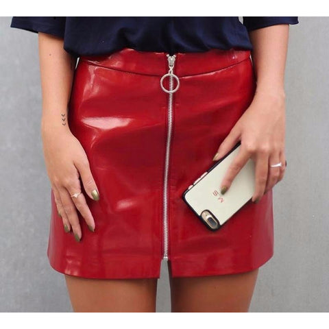 The Lydia Faux Leather Mini is a high gloss shine mini skirt made of faux leather with a zipper in the front center.