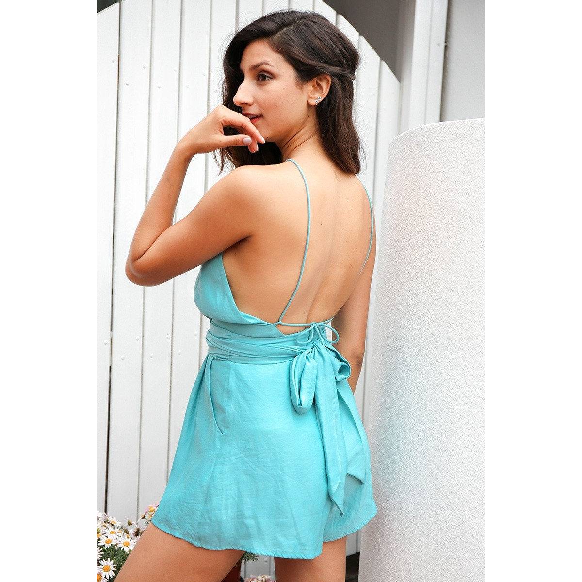 The Alexandria Halter Romper is a cute, thin strap, backless jumpsuit with a keyhole chest, and a bow tie in the back for a feminine touch. Gray and seafoam blueish-green.
