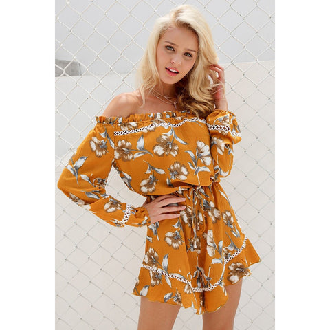 The Tiana Cold Shoulder Romper is a gorgeous boho style jumper with long sleeves, a loose waist, and a lovely floral print.