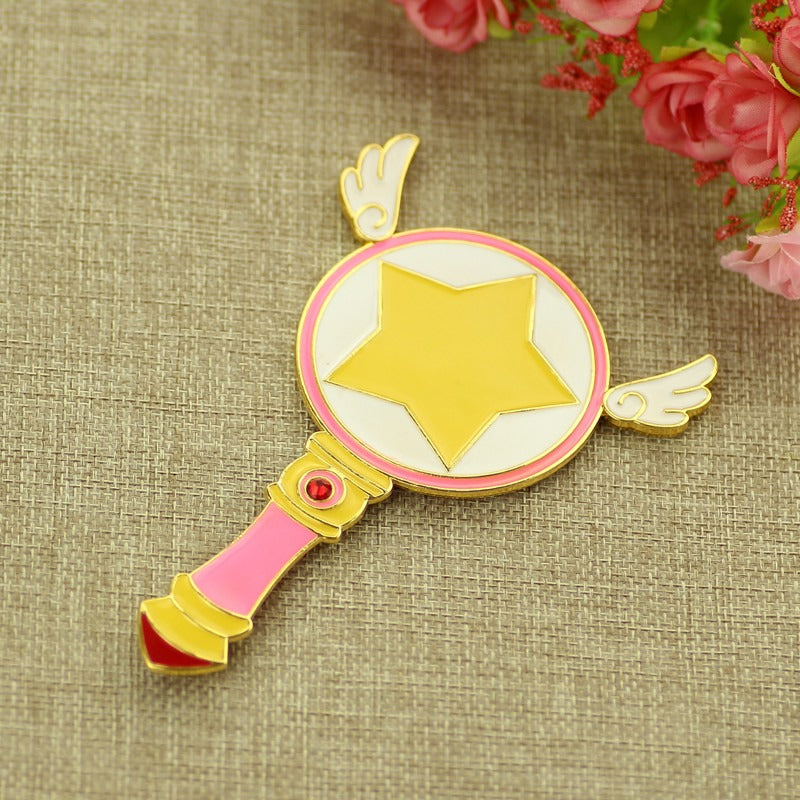 Cardcaptor Sakura Kinomoto anime themed pink hand mirror, a cute gift for any CCS fan! Design inspired by the magical sealing wand. Kawaii beauty tool.