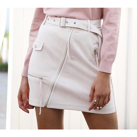 The Amalia Zipper Mini Skirt features an asymmetrical zipper design and belt on soft suede like material for a motorcycle fashion style skirt.