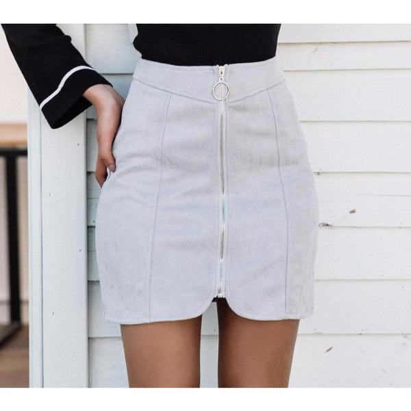 The Samantha Zipper Mini is a solid color classic style skirt made of faux leather, with a long zipper featured in the front center. Available in gray, yellow, pink, and black.