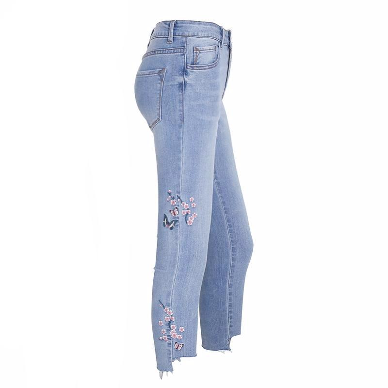 The Blossoms Embroidered Jeans are mid-waist, light wash, cotton based jeans with soft embroidered floral details on the legs and hip. | Bijou Blossoms | Fashion Clothing Boutique